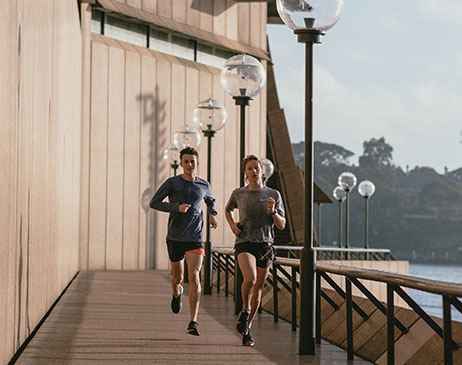 Couple jogging on promenade