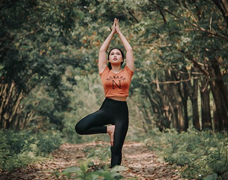 Woman in yoga pose in a forest