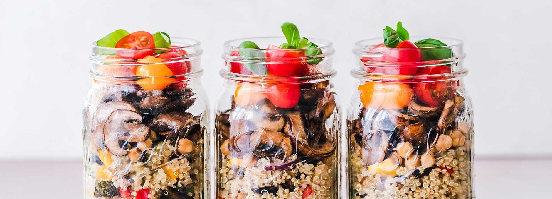 Meal prepped food stored in mason jars