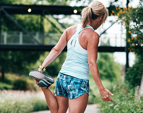 Woman warming up for a run