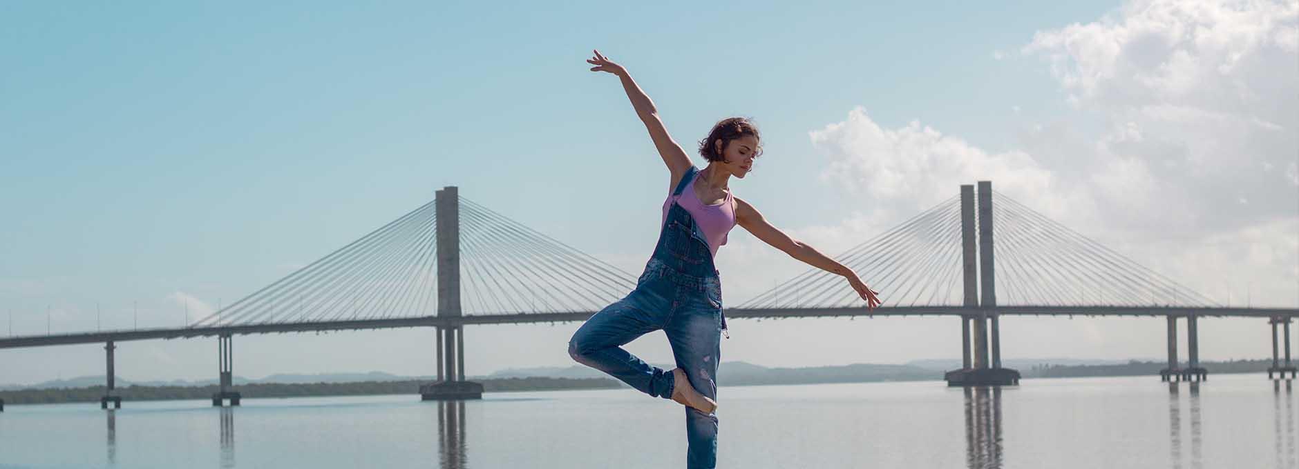 Yoga in front of bridge
