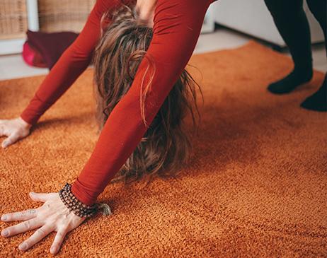 woman doing downward dog pose