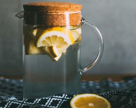 Water in a jug with lemons