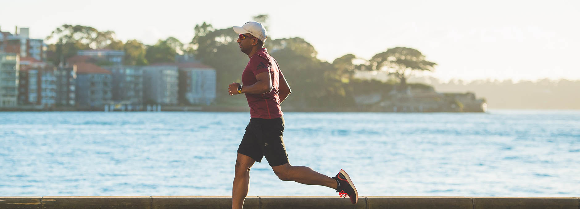 Man running on seafront