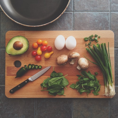 Chopping board with nutritious ingredients on top