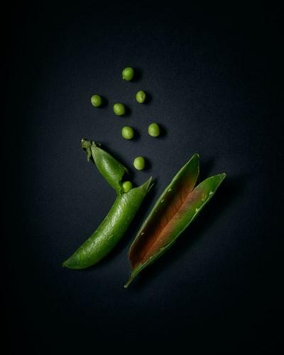 Peas on black background
